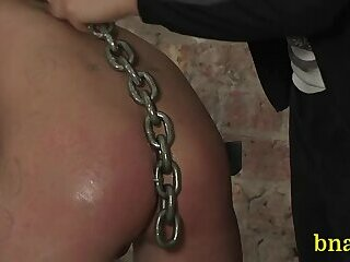 Submissive gay in a bondage scene