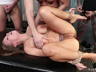 Brunette tied up gangbang fucked at gym