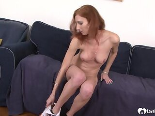 Horny redhead and her black bf fucking passionately