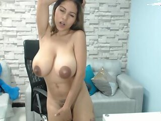 Amateur Latina with Huge Tits and Giant Nipples masturbating on webcam.