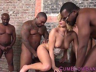 Blonde sucks black cocks in gang bang