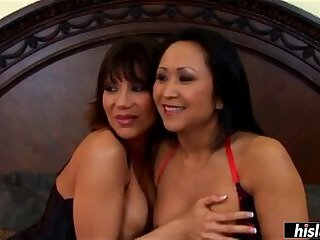 Asian MILFs sharing a huge cock