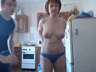 Mature in kitchen
