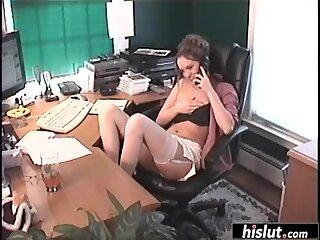 Horny secretary masturbates in the office