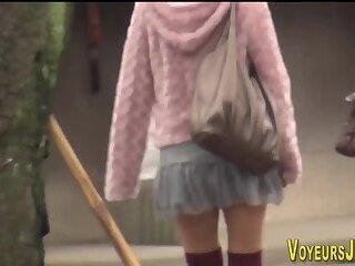 Asians in big boots show panties