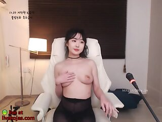 Busty Korean beauty in pantyhose