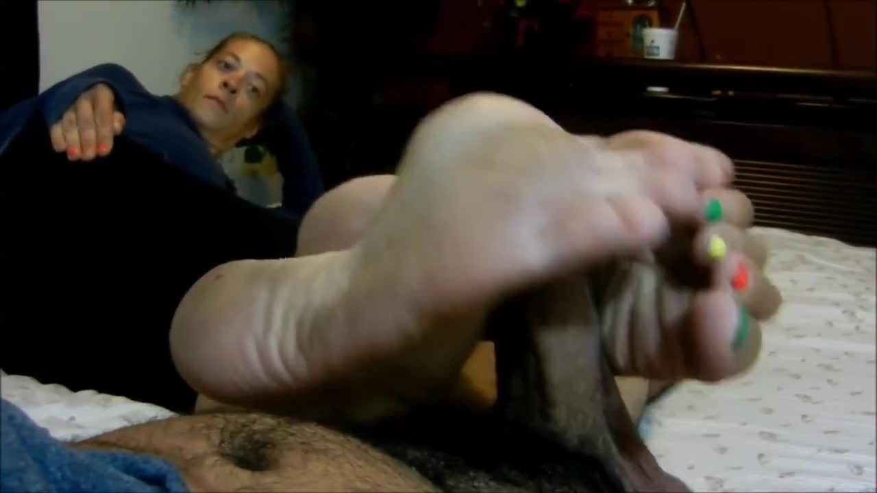 Mature feet footjob