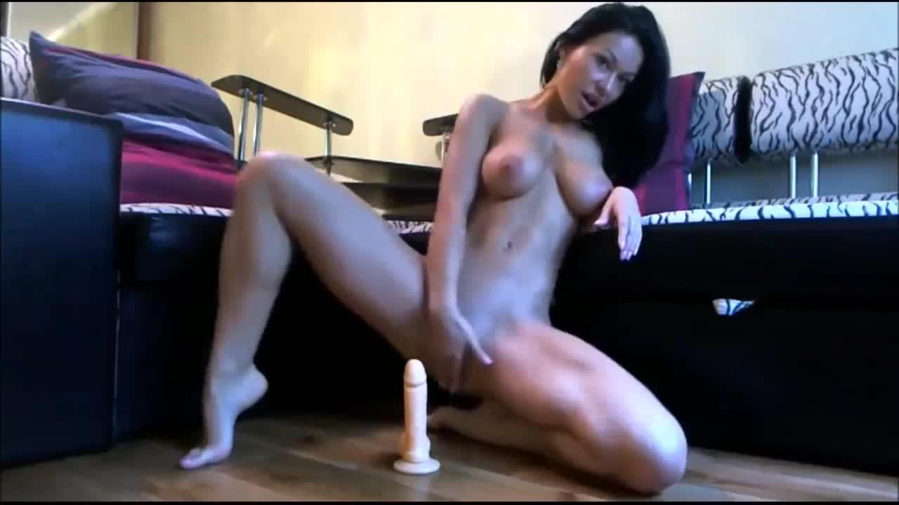 Pretty cam girl sucking dildo on webcam